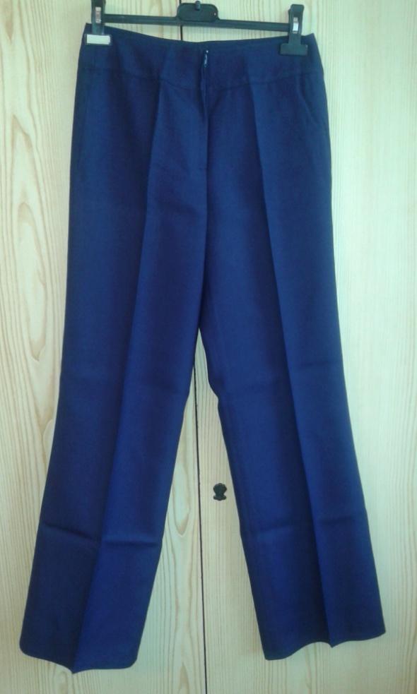Granatowe spodnie w kant XS 34