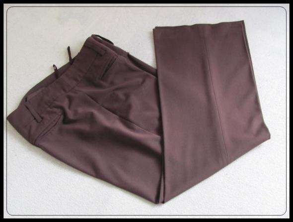 brązowe spodnie na kant eleganckie na niższą