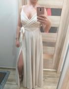 Cudna mieniaca się suknia z rozporkiem