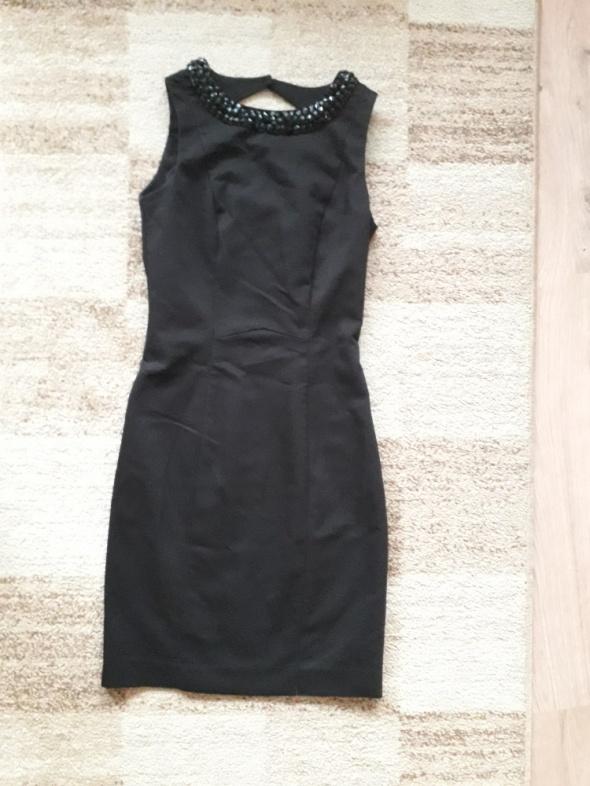 mała czarna ołówkowa sukienka H&M 34