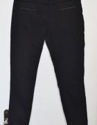Eleganckie spodnie rurki cygaretki lamówki eko skóra skórzane m...