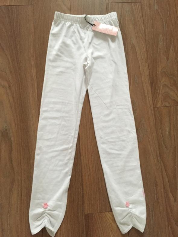 NOWE białe marszczone legginsy z różowym kwiatuszk...