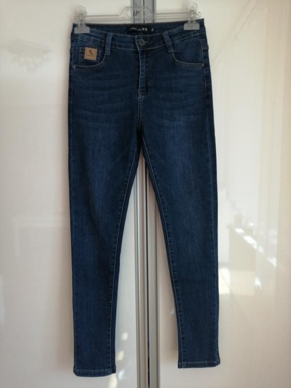 Spodnie jeansy rurki ciemne nowe...