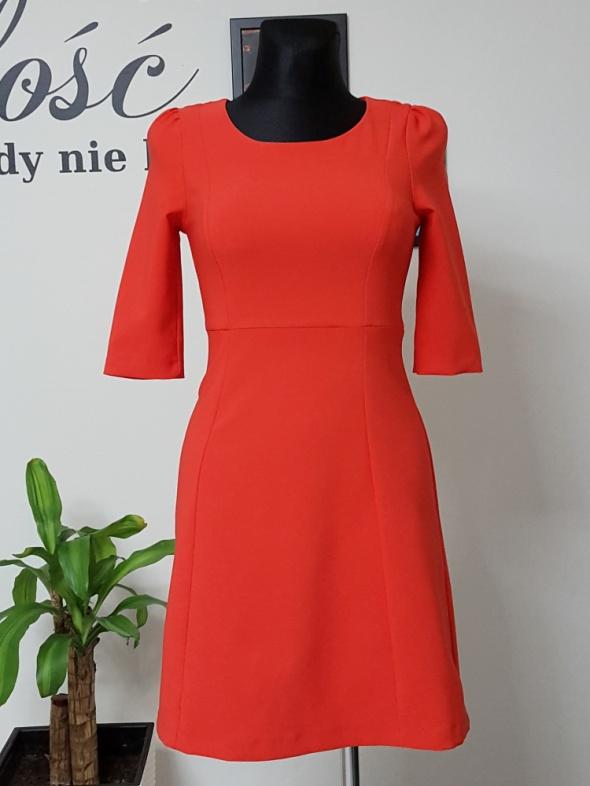 rozszerzana czerwona sukienka Orsay...