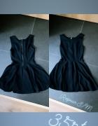 Czarna sukienka że złotym zamkiem