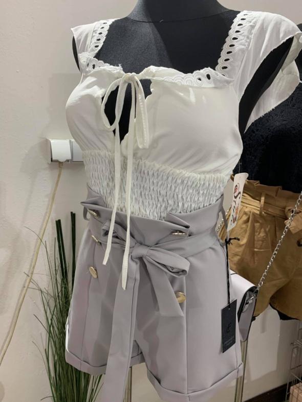 Bluzeczka biała falbany sznurowana push up mega...