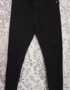 Czarne dżinsy chłopięce H&M 152...