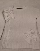 Sweterek z kokardkami jasny beż rozmiar S...