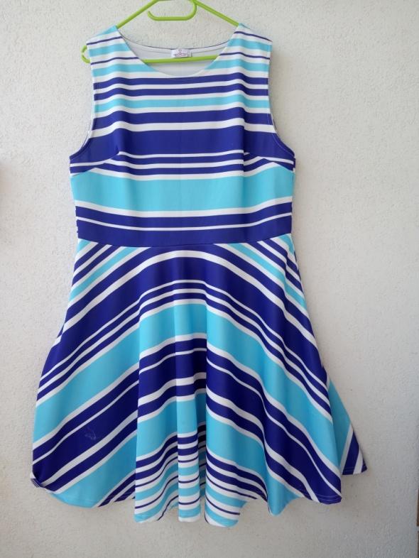 rozkloszowana sukienka w paski 48 Uk 20