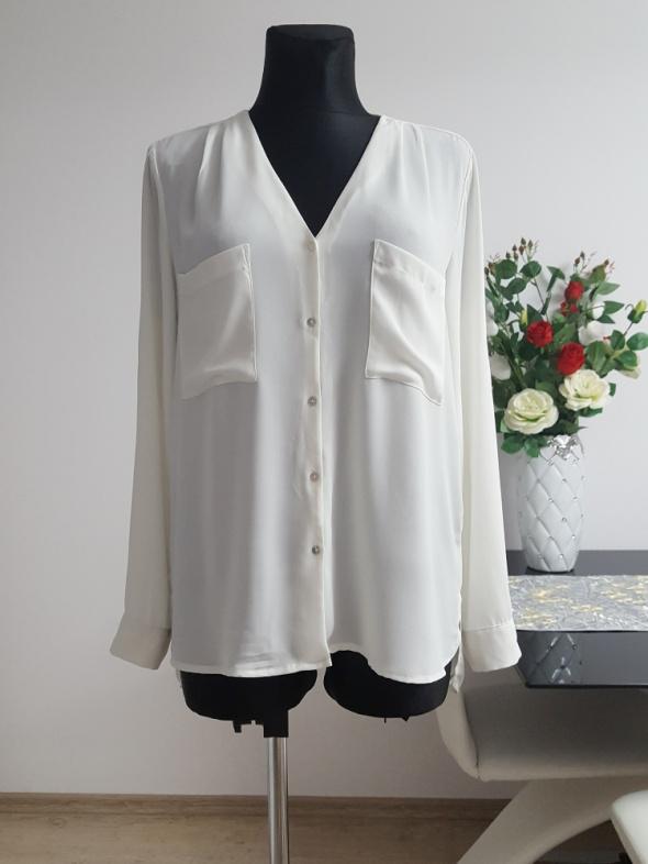 kremowa bluzka z kieszeniami H&M...