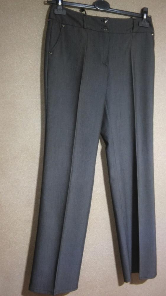 Damskie eleganckie spodnie garniturowe w kant 38