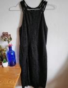 Koronkowa dopasowana sukienka...