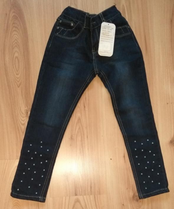 Nowe jeansowe spodnie dziewczęce z błękitnymi perełkami rozm 19 122