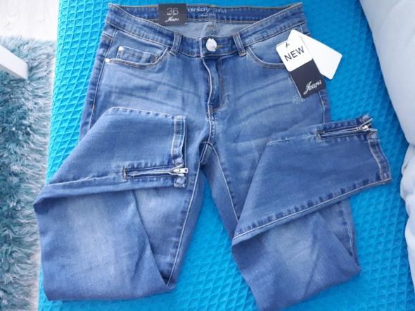 nowe spodnie z zameczkami orsay 36