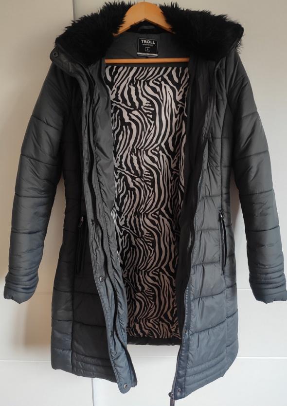 Długa kurtka z puszkiem...