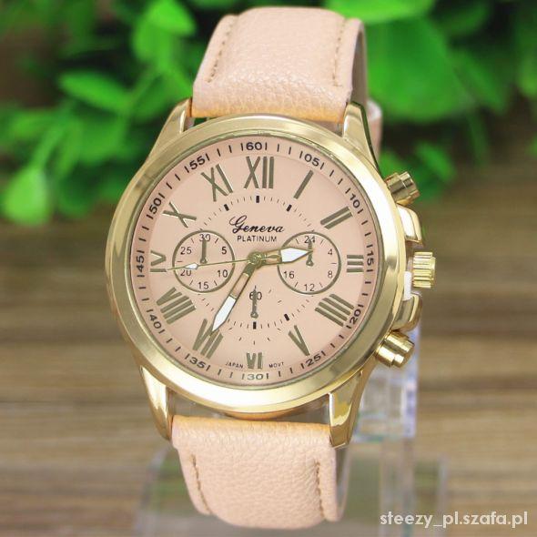 złoty zegarek masywna koperta skórzany pasek