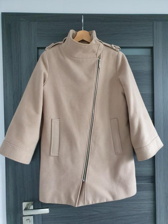 Beżowy płaszcz DanHen...