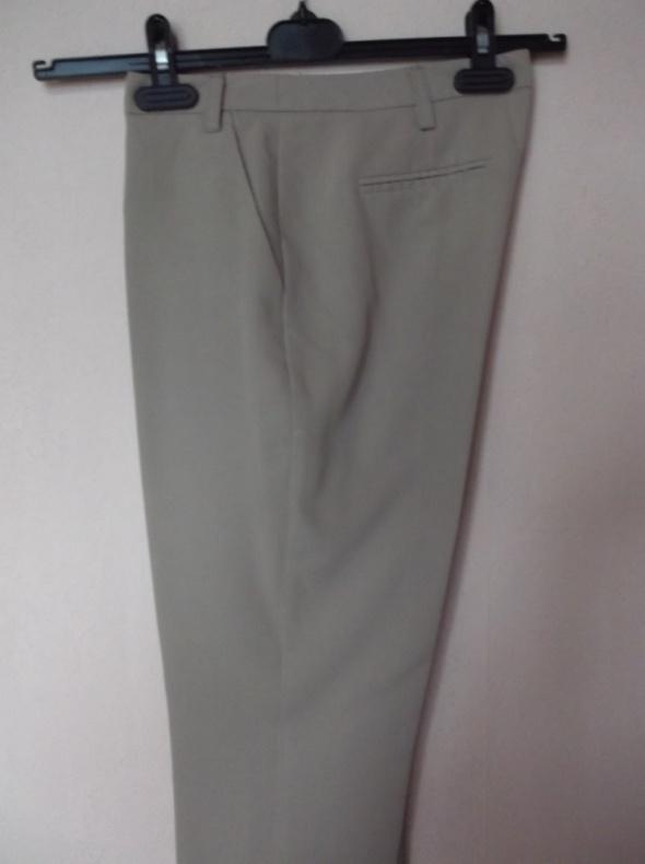 Beżowe spodnie cygaretki Atmosphere 36
