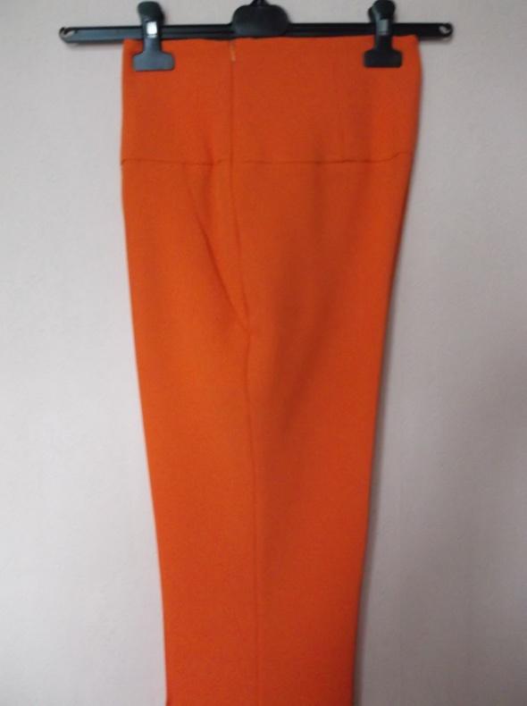 Pomarańczowe spodnie cygaretki Nowakowska 38