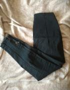 Czarne spodnie rurki zwężane z zamkami Marks&Spencer wyższy sta...