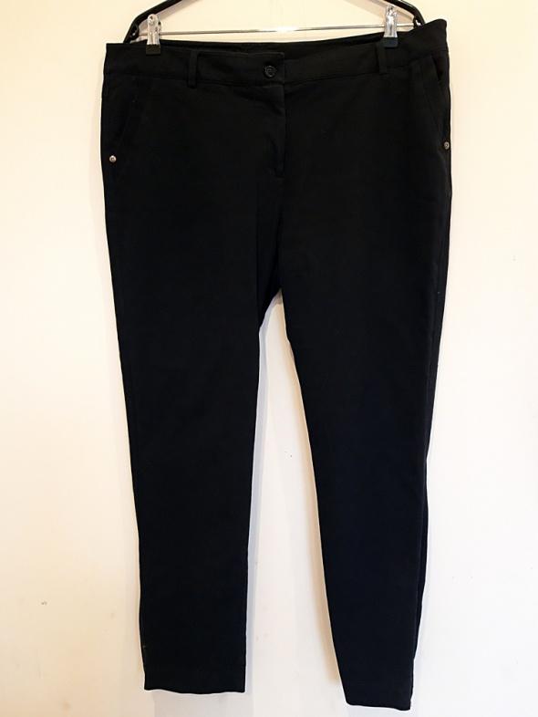granatowe spodnie Reserved 46