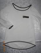 biała bluzka z czarnymi lamówkami