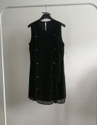Czarna sukienka Miss selfrige z perłami...