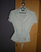 Elegancka rozpinana koszula wiązana w talii...