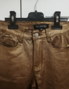 Metaliczne spodnie damskie Top Secret