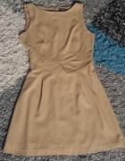 Beżowa sukienka warehouse...