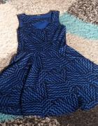 Chabrowa rozkloszowana sukienka 38