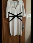 Kremowa sukienka Monnari 44...