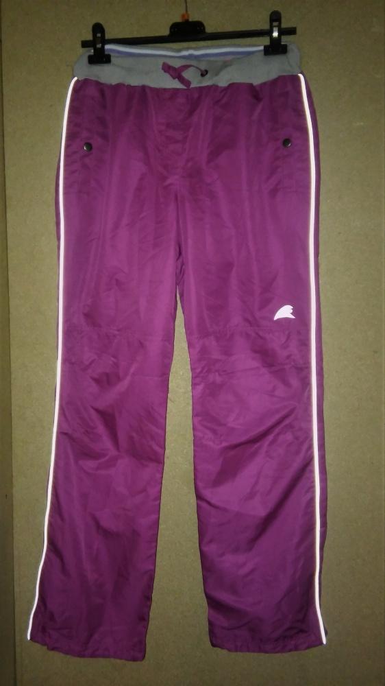 Damskie spodnie sportowe fioletowe 38...