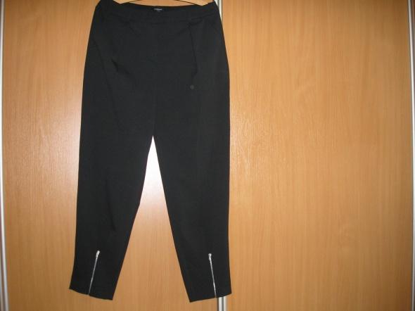 Wysoki stan spodnie z zamkami 40 nowe Concept Reserved...