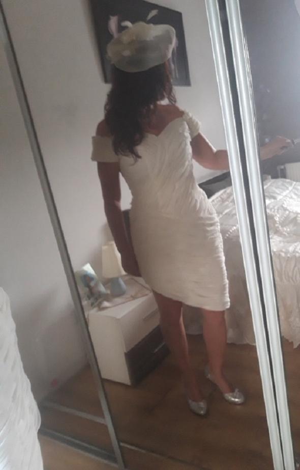 Drapowana suknia ślubna wieczorowa