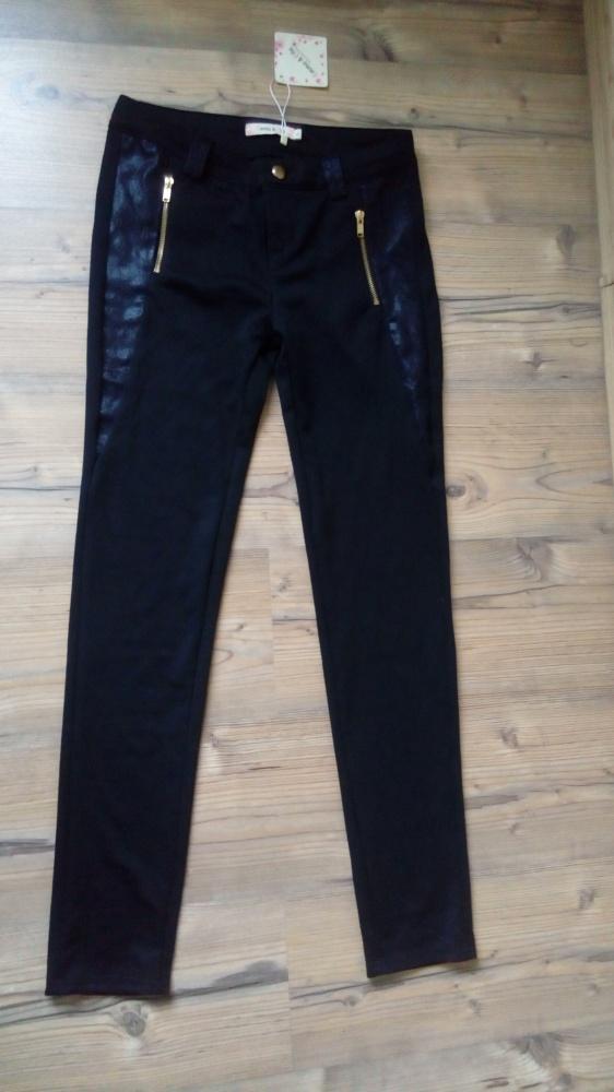 Nowe czarne spodnie ze złotymi zipami i wstawkami