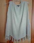 Sweterek bez rękawów z frędzelkami...