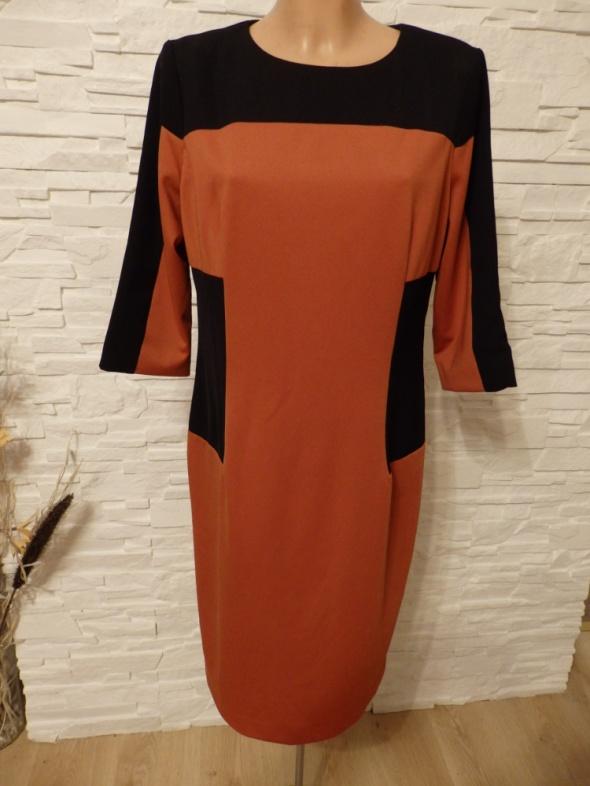 Sukienka fason optycznie wyszczuplający