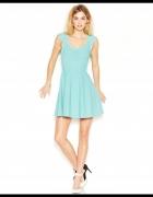 Guess elegancka bandażowa sukienka rozkloszowana 38 M niebieska...