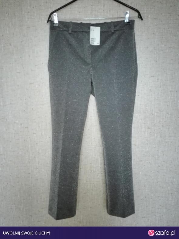 brokatowe spodnie HM w Spodnie Szafa.pl