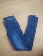 Spodnie jeans niebieskie dopasowane mohito 34...