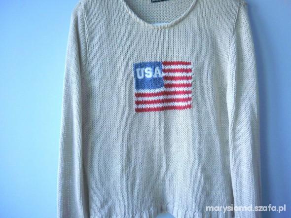 Beżowy sweter flaga USA...