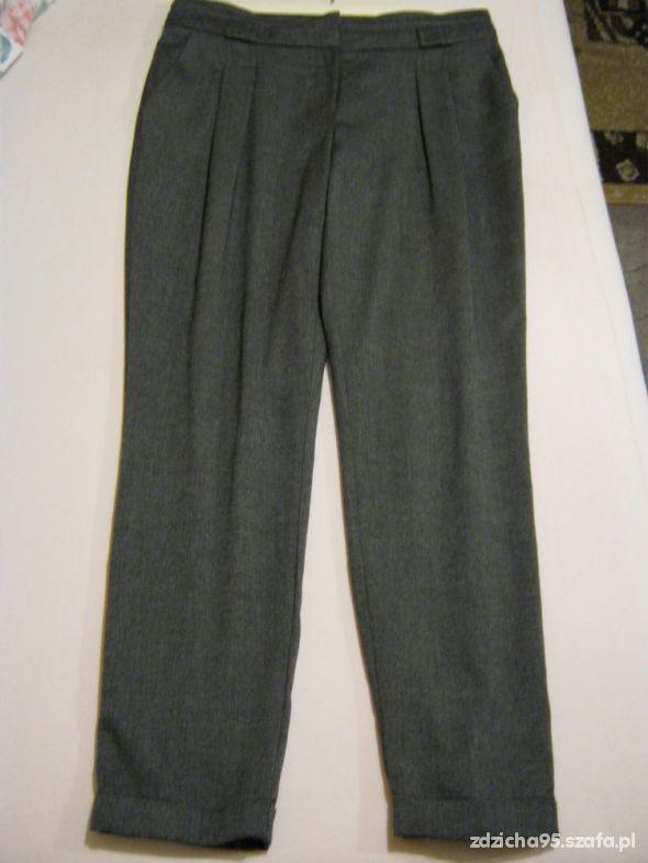 Szare spodnie Chinosy...