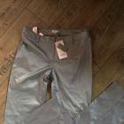 Nowe spodnie srebrne woskowane 36 38