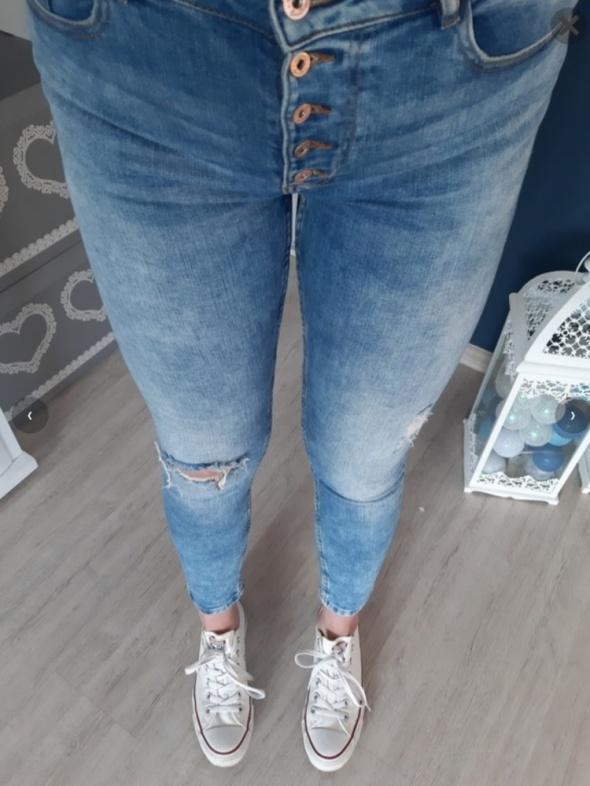 Spodnie wysoki stan guziki
