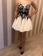 Biała sukienka z czarnym haftem...