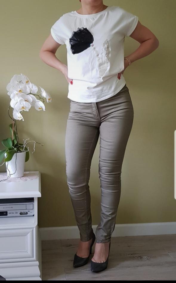 Woskowane spodnie oliwkowe