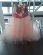 Rozkloszowana sukienka z gorsetem...