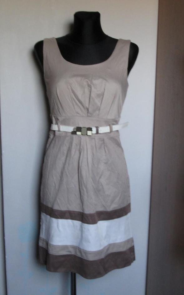Elegancka sukienka beże brązy pasek z ozdobną klamrą