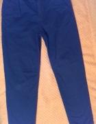 Granatowe eleganckie spodnie dla chłopca Reserved r 134
